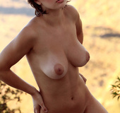 Lovely short haired Lolita with the best tits flashes amazing body outdoors