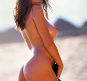 Beautiful tanned brunette flaunts her exceptional ass and perfect body