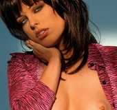 Stunning small-boobed brunette in stilettoes with deeply sexual eyes poses