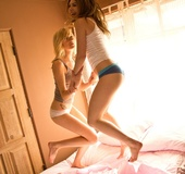 Two young girls open up for each other for some fun pussy play