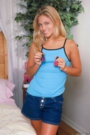 young petite blonde strips
