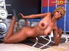 Black tranny with blue eyes shows her big boobs and big dick.