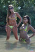 Banging babes pose their foxy bodies in a lake wearing their sexy green