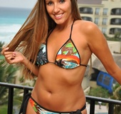 Gorgeous chick wearing her steaming hot multi colored bikini displays
