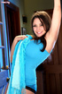 Beautiful brown-haired woman in blue top reveals huge melons