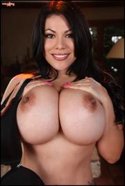 dark-haired tattooed latina strips-off