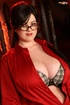 Delicious Lolita uses red lipstick and glasses while wearing red satin