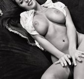 Black and white pinups of beautiful girl posing on the couch topless