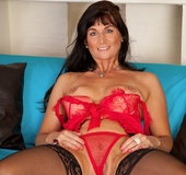 Mature long-haired babe in red lingerie plays with her raw cunt.
