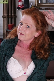 mature redhead plays with