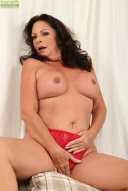 red lingerie-clad cougar strips
