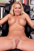 Blonde mama uses a dildo on her pussy in her library.