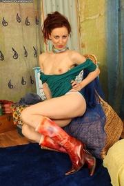 playful redhead milf strips