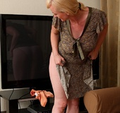 Shy blonde housewife takes a break from cleaning to fondle smooth vag.