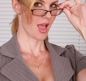 Blonde MILF prof strips and fingerbangs smooth pussy in her office.