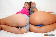 two pleasing brunettes wearing