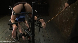 Master bends a girl in bondage equipment - XXX Dessert - Picture 11
