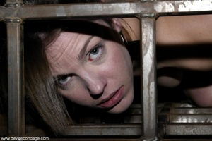 Things are definitely worse for a dark-haired slave once she is let out of her small cage. - XXXonXXX - Pic 14