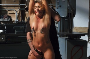 Foxy girl in heels does not stop her BDSM session, even though her face expresses how painful it is. - XXXonXXX - Pic 6