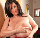 Brunette gal with gigantic boobies likes to tease everyone