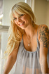 Tattooed blonde honey is ready to show her wonderful pussy