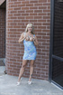 Long haired blonde model in a blue dress will impress everyone