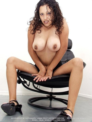 curly brunette shows fleshy