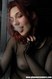 goth girl fishnets smokes