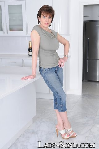 mature brunette jeans white