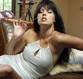 The perfect women in a white silk dress teases, strips and licks her nipples