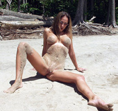 Hot skank gets turned on by the lake, takes her clothes off