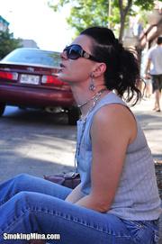 gorgeous brunette sunglasses smokes