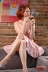 Redhead smoker chick gets naughty on her couch and flashes