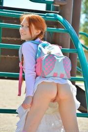 petite schoolgirl with red