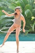 Fit brunette slut uses hula hoop and fists her tight pink asshole