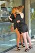 two elegant ladies undress