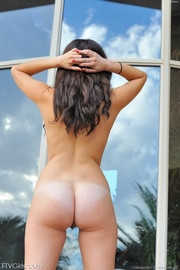 brunette bikini babe lounges