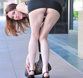 Brown eyed redhead takes a walk while flashing her perky breast and pretty