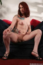 tattooed redhead shemale jerking