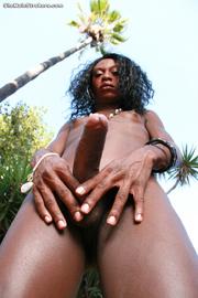 slender black ladyboy proudly