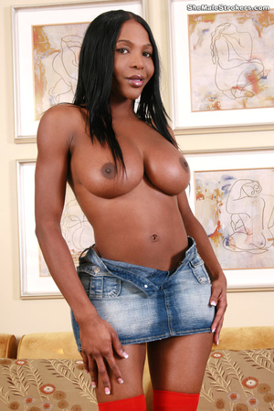 Black shemale in red stockings shows her - XXX Dessert - Picture 2