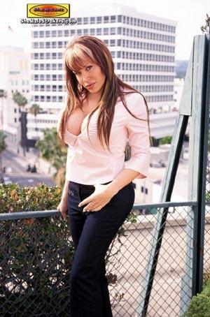 Long haired brunette tranny stroking her - XXX Dessert - Picture 1