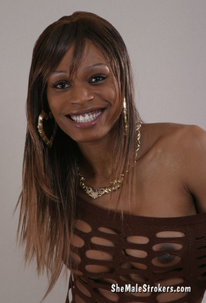 Smiling black tranny posing in a hot dre - XXX Dessert - Picture 1