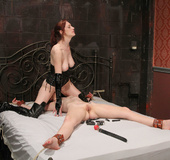 Redhead master binds babe and makes her eat pussy, whips then toy fucks