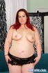 Big redhead in sexy black lingerie fingers cunt, sucks cock and creamed