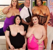 One chubby ebony babe and three brunettes strip to take turns sucking