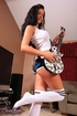 Gorgeous hottie pose her smoking hot body while she plays her guitar before
