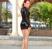 Gorgeous redhead pose her foxy body outdoor wearing her sunglasses, black