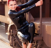 Stunning chick displays her stunning body in different poses on a train