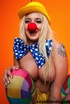 Sexy blonde in colorful clown outfit flaunts big hot tits and smooth round